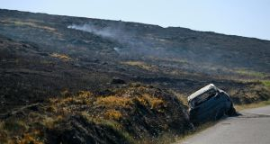 Burnt out remains of vehicle. Photograph: Nick Bradshaw/ The Irish Times