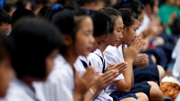 Students pray at Mae Sai Prasitsart school in northern Thailand a search continued for 12 boys and their soccer coach missing in a cave since June 23rd. Six of the boys study at the school. Photograph: Soe Zeya Tun/Reuters