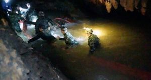 Thai rescue teams walk inside cave complex where 12 boys and their soccer coach went missing, in Mae Sai, Chiang Rai province, in northern Thailand. Photograph: AP