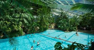 "A Center Parcs ""subtropical swimming paradise"" – a vast indoor swimming pool with slides and water rides"