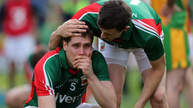 Lee Keegan of Mayo is consoled by Jason Doherty following defeat to Donegal in the 2012 All-Ireland final at Croke Park. Photograph: Donall Farmer/Inpho