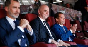 King Felipe VI of Spain, Fifa president Gianni Infantino and Russian prime minister Dmitry Medvedev at the World Cup match between Spain and Russia in Moscow. Photograph: Dmitry Astakhov/Sputnik/EPA