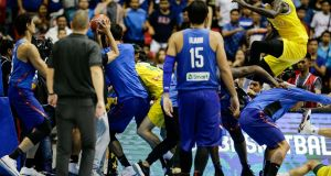 A brawl erupts between players from the Philippines (blue shirts) and Australia in Manila. Photograph: PA