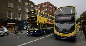 Dublin Bus on Nassau Street: decades-old routes will be replaced by new itineraries. Photograph Nick Bradshaw