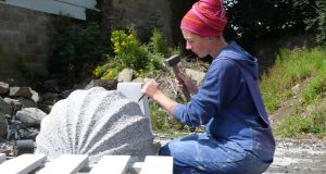 Sculptor Helen O'Connell at work carving limestone.