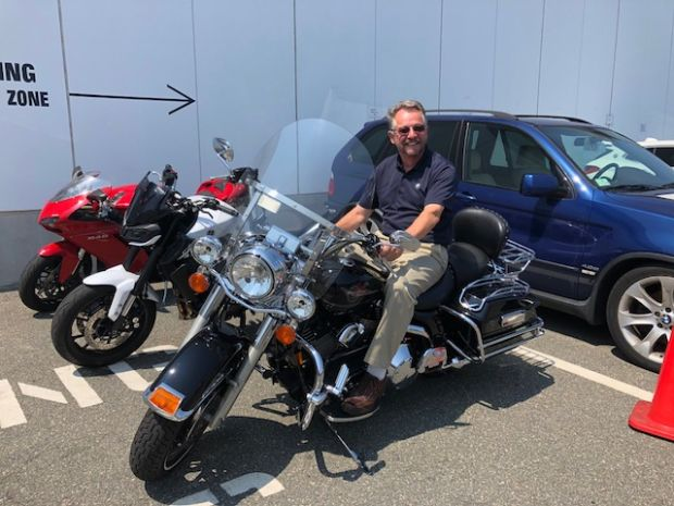 John Cotter enjoying the sun on his Harley in Melrose, MA.