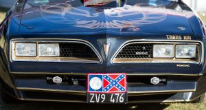 A car pictured with confederate flag number plates at US Independence Day celebrations at the Phoenix Park event. Photo: Tom Honan