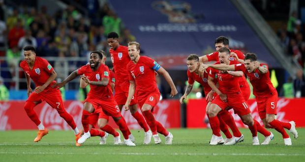 6e1d3b705 England players react after Eric Dier scored the winning penalty during the  shootout against Colombia in
