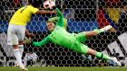 England's Jordan Pickford saves a penalty from Carlos Bacca of Colombia during their World Cup quarter-final clash in Moscow. Photo: Alberto Estevez/EPA