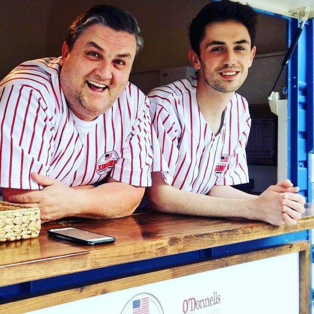Simon Delaney (left) in his Simply Simon's US diner food truck at Kildare Village