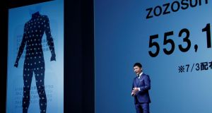 Yusaku Maezawa, the chief executive of Zozo,  speaks in front of a projection about Zozosuit at an event launching the debut of its formal apparel items in Tokyo on July 3rd. Photograph: Kim Kyung-Hoon/Reuters.