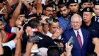 Malaysia's former prime minister Najib Razak greets his supporters as he leaves a court in Kuala Lumpur on Wednesday. Photograph: Lai Seng Sin/Reuters