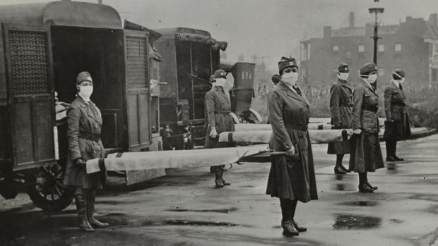 St Louis Red Cross Motor Corps on duty during the influenza epidemic in 1918. Photograph: Universal History Archive/UIG via Getty Images