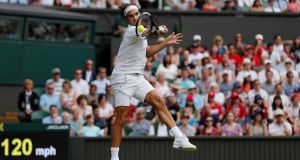 Switzerland's Roger Federer in action during the second-round match against Slovakia's Lukas Lacko at  Wimbledon. Photograph: Andrew Couldridge/Reuters