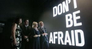 Seamus Heaney's children Catherine, Chris and Mick, and the poet's widow, Marie Heaney at a piece by artist Maser, Don't Be Afraid. Photograph: Gareth Chaney/Collins