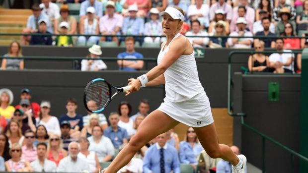 Ekaterina Makarova of Russia returns to Caroline Wozniacki of Denmark in their second-round match during the Wimbledon Championships. Photograph: Gerry Penny/EPA