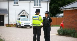 Police officers stand in front of a housing development on Muggleton Road, Amesbury, which has been cordoned off. Photograph: Henry Nicholls/Reuters.
