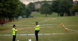Police officers stand next to a section of playing field near Amesbury Baptist Church  in Amesbury. Photograph: Henry Nicholls/Reuters.