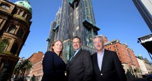 Caitriona Lavery and Howard Hastings are joined by John McGrillen of  Tourism NI at launch of Belfast's Grand Central Hotel which opened in June.