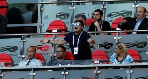 Diego Maradona reacts in the stands during the France v Argentina last 16 match as Mikael Silvestre and Ronaldo look on. Photo: John Sibley/Reuters