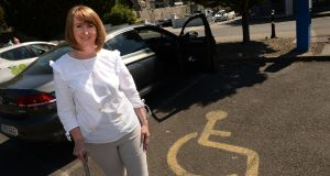 Olivia Shiel, who suffers from chronic pain and fatigue from a spinal cord injury, is often forced to park some distance from the school because of people illegally parked in the disabled space. Photograph: Dara Mac Dónaill/The Irish Times