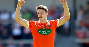 Niall Grimley celebrates Armagh's victory over Clare in the qualifier at the Athletic Grounds. Photograph: Ryan Byrne/Inpho