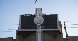 An Islamic State emblem in Mosul, Iraq. A man who tried to go to fight for Isis in Syria has been jailed for 2.5½years for transferring money to and attempting to raise funds for the terrorist organisation. Image: iStock.