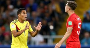England defender John Stones has words with  Carlos Bacca after the Colombia player received a yellow card in the round of 16 World Cup match at the Spartak Stadium in Moscow. Photograph:  Tim Goode/PA Wire