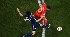 Japan's  Gaku Shibasaki  challenges Belgium's  Eden Hazard during the  World Cup round of 16 football match  at the Rostov Arena. Photograph: Jewel Samad/AFP/Getty Images