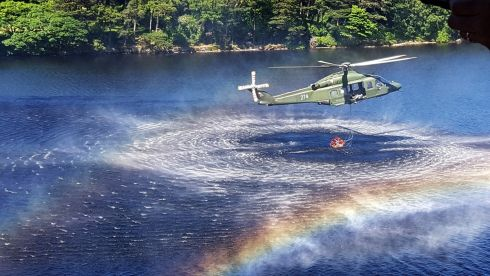 LOADING UP: Defence Forces helicopter collects water during a firefighting operation in the west of Ireland
