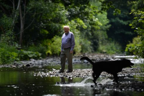 LAST GOODBYE: John Chambers, chair of the Irish Federation of Pike Angling Clubs, standing in the low levels of the Dodder river, in Rathfarnham, Dublin. Their members have agreed to stop fishing there. Photograph: Dara Mac Donaill/The Irish Times