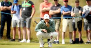 Rory McIlroy  lines up a putt on the third green  during the first round of the Dubai Duty Free Irish Open at Ballyliffin Golf Club. Photograph:  Jan Kruger/Getty Images