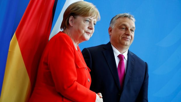 German chancellor Angela Merkel and Hungarian prime minister Viktor Orban shake hands after addressing the media in Berlin, Germany. Photograph: Reuters/Axel Schmidt