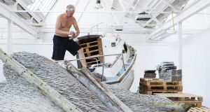David Mach working on his installation Rock'n'Roll. Photograph: Andrew Downes