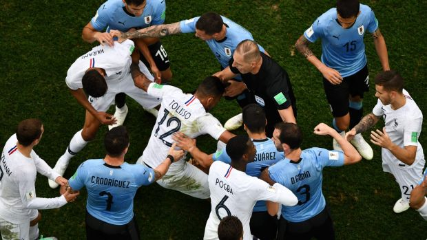 Players crowd around Kylian Mbappe after he went down.Photo: Antonin Thulier/Getty Images
