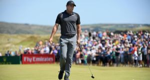 Rory McIlroy reacts to a missed putt making bogey on the ninth green during the second round of the Dubai Duty Free Irish Open at Ballyliffin Golf Club. Photo: Ross Kinnaird/Getty Images