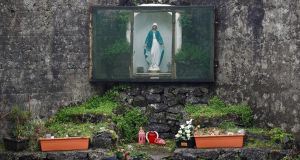 A shrine in the corner of an enclosed area on part of the site of the former mother and baby home run by the Bon Secours nuns in Tuam. Photograph: Peter Nicholls/Reuters