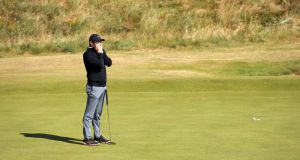 Rory McIlroy after missing a putt on the 18th during his second round at Ballyliffin Golf Club. Photograph:   Kelvin Boyes/Press Eye