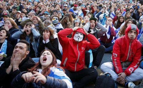 FACE IN THE CROWD: Fans watch a broadcast of the World Cup quarter-final between Uruguay and France, in downtown Montevideo. Photograph: Andres Stapff/Reuters