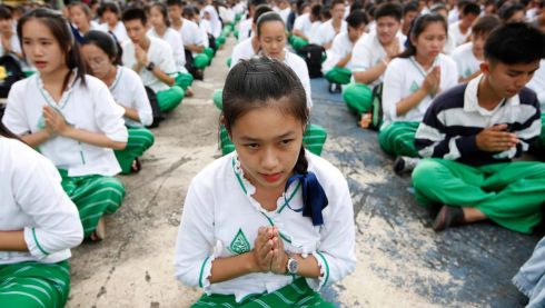 THAI CAVE RESCUE: Thai students pray for the ongoing rescue operations for a child soccer team stuck in a cave, at a school in Chiang Rai province. Photograph: Rungroj Yongrit/EPA