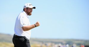 Shane Lowry of Ireland fist pumps after making a birdie on the ninth green during the second round of the Dubai Duty Free Irish Open at Ballyliffin Golf Club. Photo: Ross Kinnaird/Getty Images