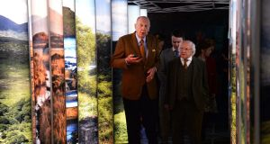 Neville Isdell with President Michael D Higgins on his visit to the museum. Photograph: Dara Mac Dónaill
