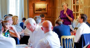 Theresa May speaks to members of her cabinet at the prime minister's rural country residence, Chequers, west of London. Photograph: Joel Rouse/AFP/Getty Images