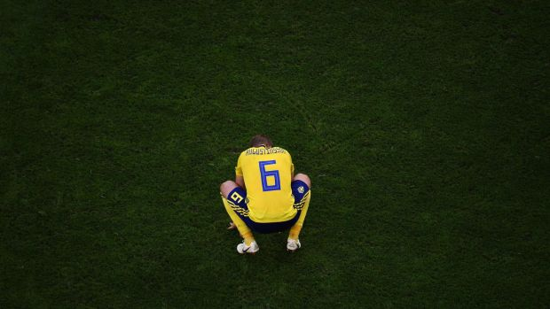 Sweden's defender Ludwig Augustinsson reacts after their defeat. Photograph: Getty Images