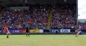 Roscommon's Colm Lavin saves a penalty taken by Rory Grugan. Photograph: Bryan Keane/Inpho