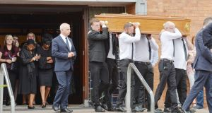 The remains of Joe O'Callaghan, Douglas are taken from the Church of the Incarnation in Cork, following requiem mass with his widow Angeline being comforted as she walks behind. Photograph: Provision