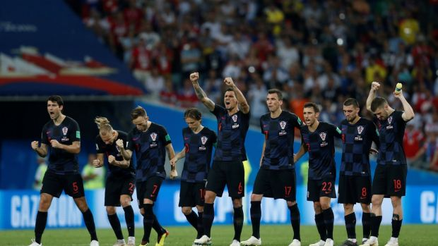 Croatia players celebrate Marcelo Brozovic's penalty during the shootout. Photograph: Carl Recine/Reuters