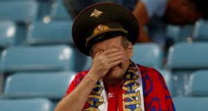 A dejected Russia fan at the end of the  World Cup quarter-final against Croatia in Sochi. Photograph: Carl Recine/Reuters