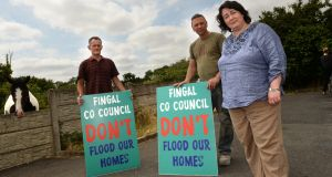 Coolquay residents Liam O'Grady, Joe Finnegan and Alvean Finnegan at the proposed site in north Co Dublin for the Traveller halting site. Photograph: Dara Mac Donaill