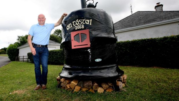 Part-time fireman Adrian Flood with his entry, the 'Potbelly Stove'. Photograph: Brian Farrell